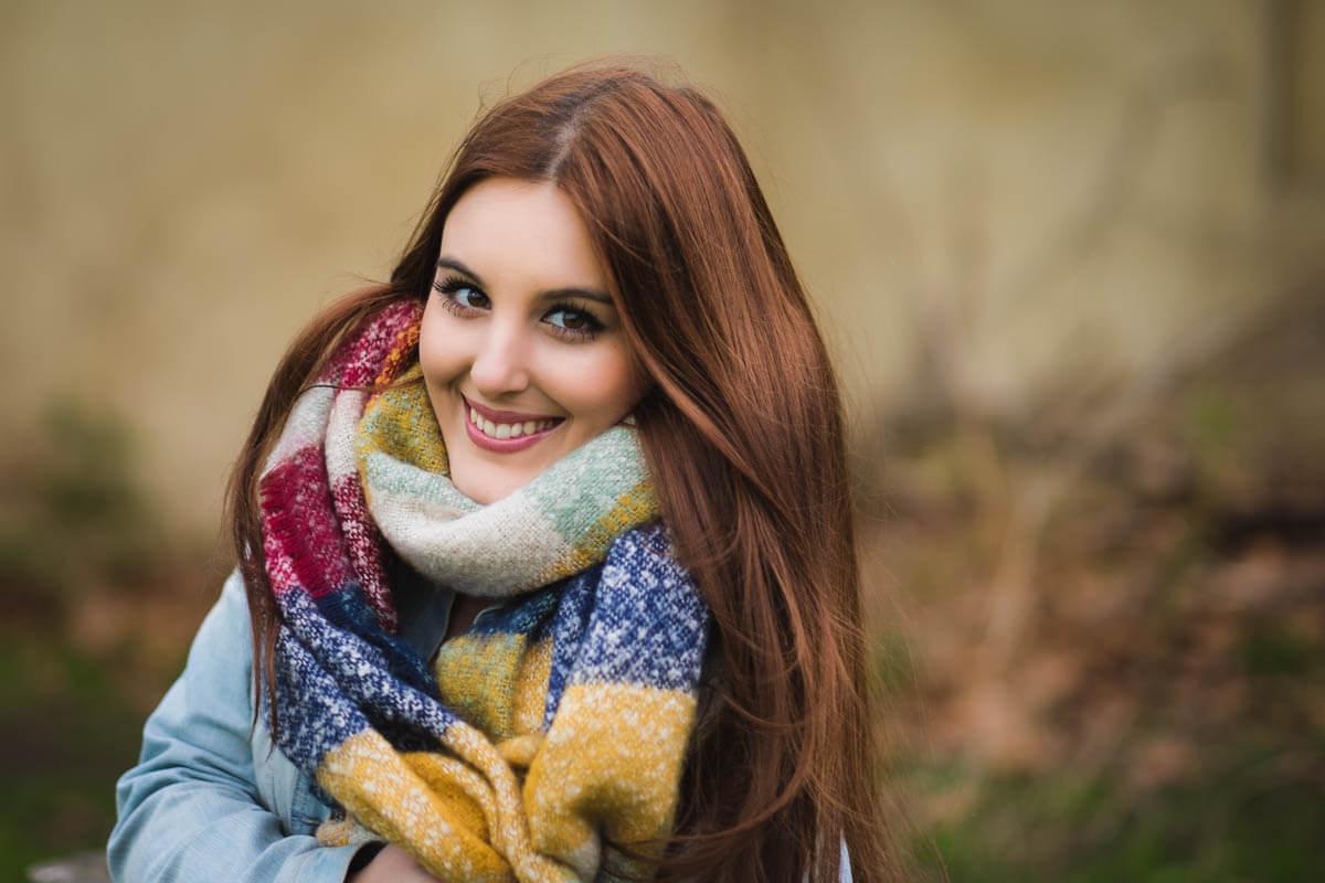 autumn portrait woman in big scarf