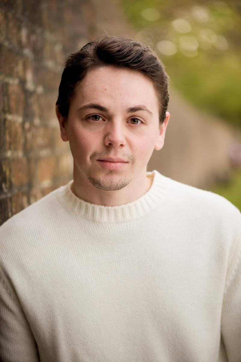 male actor headshot in cream jumper