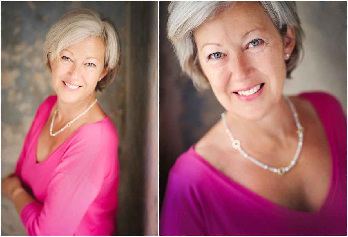 old woman wears pink jumper