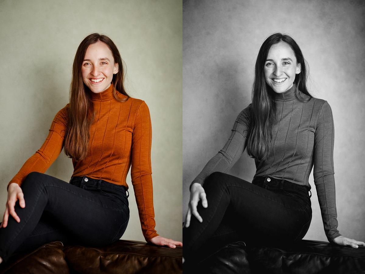 writer in orange jumper smiles